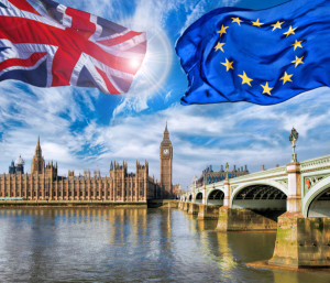 European Union and British Union flag flying against Big Ben in London England UK Stay or leave Brexit