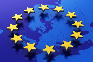 Creative abstract 3D illustration of European Union EU flag with blue contour map of Europe and circle of gold stars