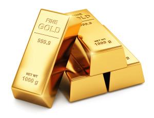 Stack of shiny gold ingots bars or bullions isolated on white background