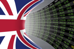 Flag of the United Kingdom with a large display of daily stock market price and quotations during economic booming period. The fate and mystery of the UK stock market tunnel/corridor concept.