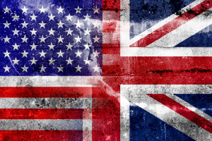 USA and UK Flag painted on grunge wall. Vintage and old look.