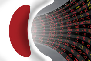 Flag of Japan with a large display of daily stock market price and quotations during economic stagnant period. The fate and mystery of Japan stock market tunnel/corridor concept.