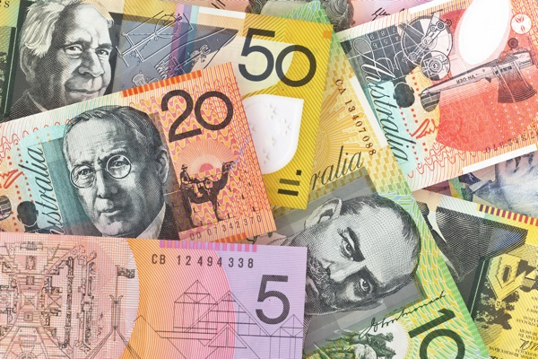 Aussie edges higher on business confidence